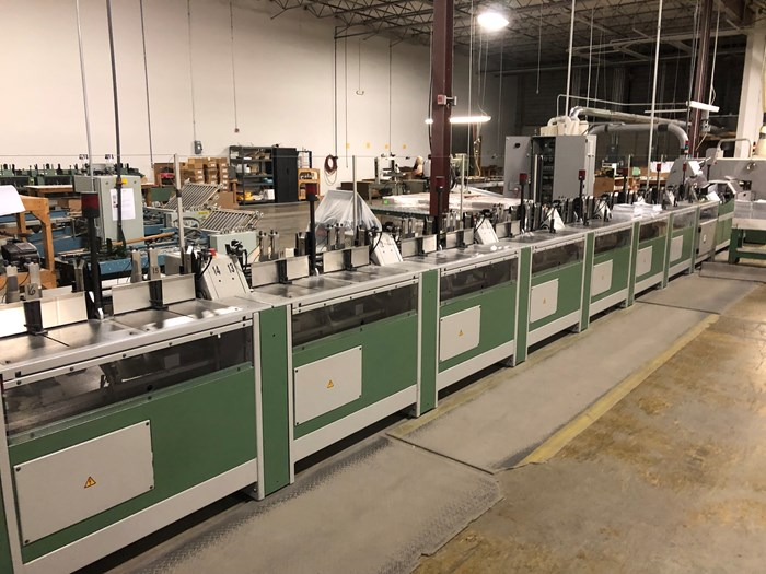 Muller Pantera 16 pocket, 12 clamp perfect binding line with Esprit trimmer & Nordson PUR