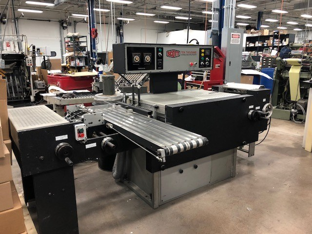Scott 10000 tab cutting and mylar applicating machine