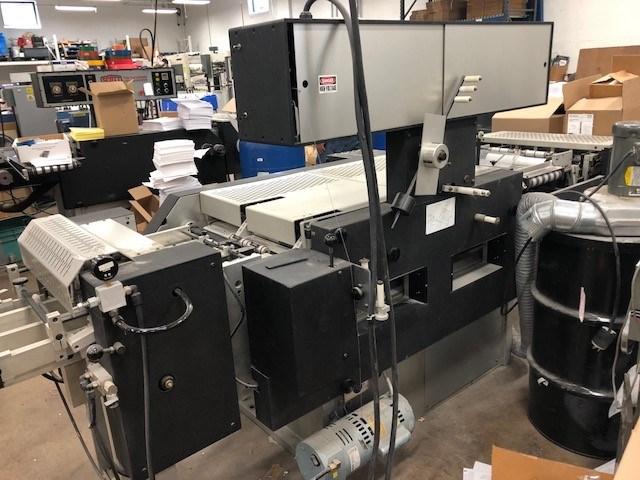 Scott 10000 tab cutting and mylar applicating machine