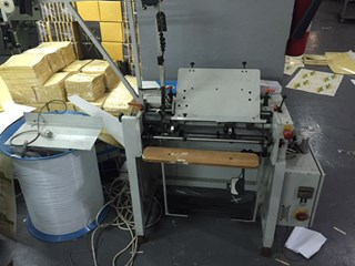 Automatic wire spiral inserting machine