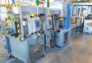 Two lines of Ferag SSP Strappers with an in-line AFFELDT SA20 automatic wrapping machine.