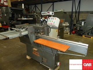 Rosback saddle stitcher with three knife trimmer